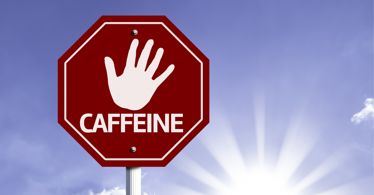 Stop Caffeine red sign with sun background